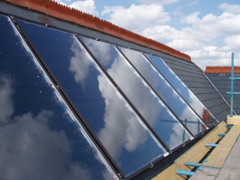 Solar panels mounted on a slate roof